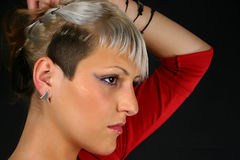 Young women. Hair style, isolated on black background Royalty Free Stock Photography