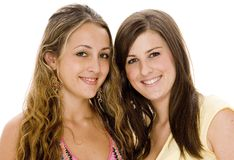 Young Women. Two attractive young women with great smiles on white background Stock Photos