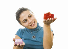 Young women. Comparing two presents Stock Photo