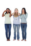 Young women acting out three wise monkeys Royalty Free Stock Image