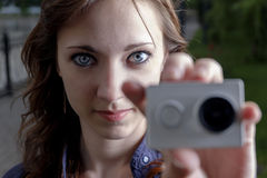 Young women with action camera in hand closeup Stock Images
