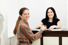Young woman administrator in a dental clinic in the workplace. Admission of the client. Young women administrator in a dental clinic in the workplace. Admission stock photos