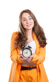 The young women with alarm clock against white bac Royalty Free Stock Photography