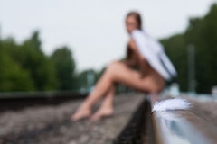 Young women an angel on the railway royalty free stock photos