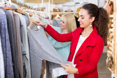 Young women at the apparel store Stock Photos