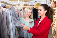 Young women at the apparel store Royalty Free Stock Images