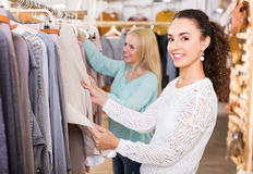 Young women at the apparel store Royalty Free Stock Image