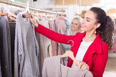 Young women at the apparel store Stock Photography
