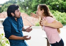 Young woman arguing with latin american friend Stock Photography