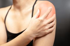 Young women arm and shoulder pain injury, healthcare and medical concept. Young woman arm and shoulder pain injury, healthcare and medical concept stock image