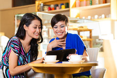 Young women in an Asian coffee shop Royalty Free Stock Images