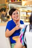 Young women in an Asian coffee shop Stock Photos