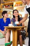 Young women in an Asian coffeeshop Stock Image