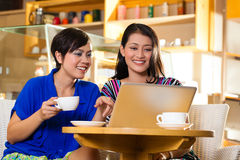 Young women in an Asian coffeeshop Stock Images