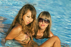Young Women At A Swimming Pool Stock Images
