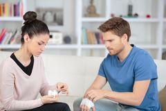 Young woman bandage boyfriend with first aid kit Stock Images