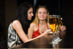 Young women in a bar Stock Image