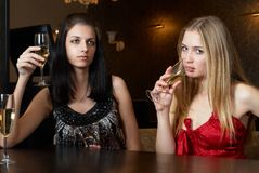 Young women in a bar Stock Images