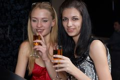 Young women in a bar Royalty Free Stock Photos