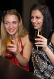 Young women in a bar Stock Photos