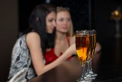 Young women in a bar Royalty Free Stock Photo