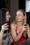 Young women in a bar Royalty Free Stock Photography