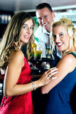 Young women and bartender in club or Bar Royalty Free Stock Photos
