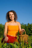 Young Women with basket on glade Stock Images