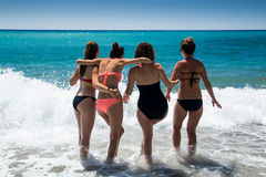 Young women on the beach Stock Image