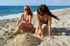 Young women on a beach in Italy Stock Images