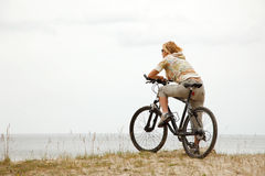 Young women with bicycle Royalty Free Stock Photo