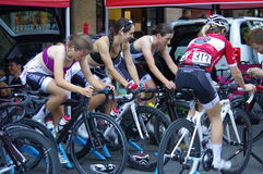 Young women on bicycles. Warming up for Global Relay Gastown Grand Prix in Vancouver, Canada Royalty Free Stock Photos