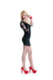 Young women with blond hair posing in little black dress Royalty Free Stock Photography