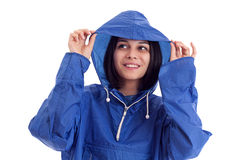 Young women in a blue rain coat Royalty Free Stock Images
