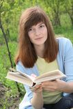 Young Woman with a book. Girl (Young Woman) with a book on a background nature Royalty Free Stock Images