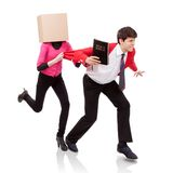 Flee the evil desire. Young women with a box on her head grab a young men with Bible in hand Stock Photo