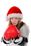 Young women with boxing gloves. Young women in santa's hat with boxing gloves stock photography