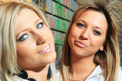 Young women with a brick wall Royalty Free Stock Image