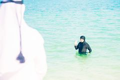 Young Woman In Burkini Swimming In The Sea Royalty Free Stock Photography
