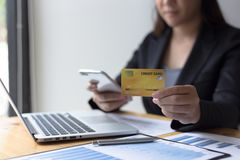Young women are buying products online via the internet and making payments via credit cards. Online stock photography