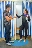 Young woman buying wetsuit. Young women buying a wetsuit Stock Photos
