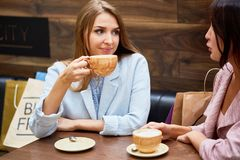 Young Women in Cafe at Shopping Center stock images