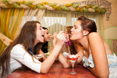 Young women in the caffee Royalty Free Stock Photos