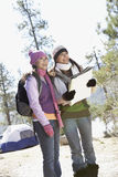 Young Women At Campsite With A Map Stock Image