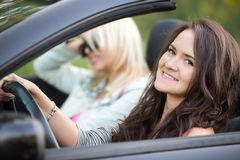 Young women on a car trip Stock Images
