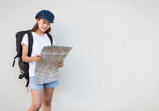 Young women carry bag and looking map Stock Photography
