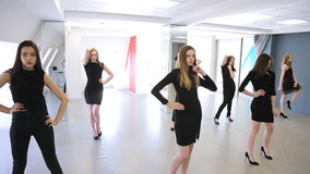 Young women are changing pose standing in model school. stock video footage