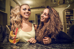 Young women chatting in a pub Royalty Free Stock Images