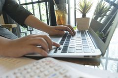 Young women are checking the company`s finances to prepare business development stock image