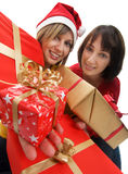 Young women with Christmas presents Stock Photos